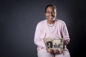 Judith Brown holds WWII photos from Japan that her father found in 1998. Sasakawa USA assisted with translating and providing historical context for the photos. Photo courtesy The News & Advance